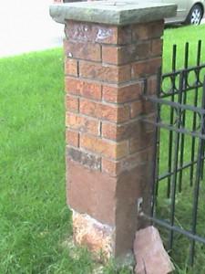 Brick post in need of repair.