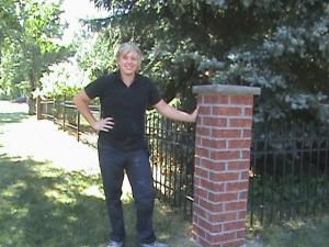 Clint Turnbull standing next to brick post.