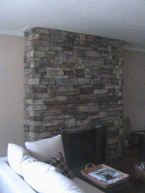 Stone fire place in living room.