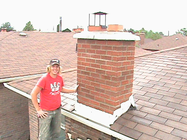 Clint Turnbull in front of repaired chimney.