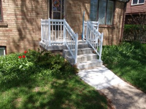 Concrete stairs and front porch.