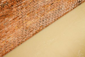 Brick wall with flood water.