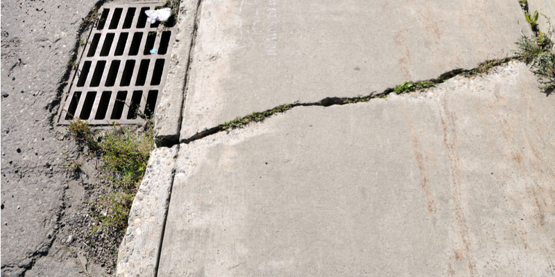 How to Know When to Fix Cracked Sidewalks + Repair Suggestions